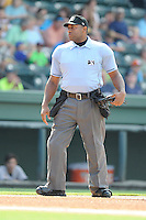 Home plate umpire Randy Rosenberg works a game between the Asheville Tourists and the Greenville Drive on Sunday, July 20, 2014, at Fluor Field at the West End in Greenville, South Carolina. (Tom Priddy/Four Seam Images)