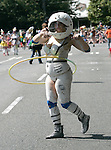 A  space woman Hula Hoops during the 25th  Annual Fremont Summer Solstice Parade in Seattle on June 22, 2013.      UPI Photo/Jim BryantPainted nude bicyclists  ride during the 25th  Annual Fremont Summer Solstice Parade in Seattle on June 22, 2013.     ©2013.  Jim Bryant.  ALL RIGHTS RESERVED.