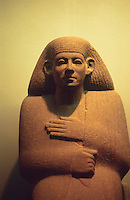 "World Civilization:  Egypt--Ankhrekhu, 12th Dynasty, about 1850 B.C.  Head and chest of quartzite.  He wears a long cloak from which only his hands emerge. Statue is about 30"" high. Large ears a convention.  British Museum."