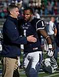 Nevada's Athletic Director Doug Knuth greets senior Brandon Wimberly before the game against the BYU Cougars played at Mackay Stadium on Saturday afternoon, November 30, 2013 in Reno, Nevada.