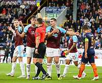Burnley's Kevin Long reacts after being shown the yellow card by referee Istvan Kovacs<br /> <br /> Photographer Alex Dodd/CameraSport<br /> <br /> UEFA Europa League - Third Qualifying Round 2nd Leg - Burnley v Istanbul Basaksehir - Thursday 16th August 2018 - Turf Moor - Burnley<br />  <br /> World Copyright © 2018 CameraSport. All rights reserved. 43 Linden Ave. Countesthorpe. Leicester. England. LE8 5PG - Tel: +44 (0) 116 277 4147 - admin@camerasport.com - www.camerasport.com