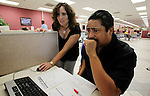 Unemployed Sergio Fuentes, right, gets some help by a state worker for a job at the State of California Employment Development Department in San Jose, Calif., Tuesday, Sept. 1, 2009. (AP Photo/Paul Sakuma)