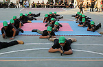 Palestinian youths take part in a military graduation ceremony at a Hamas summer camp in al-Bureij in the central of Gaza strip, August 20, 2017. Photo by Ashraf Amra