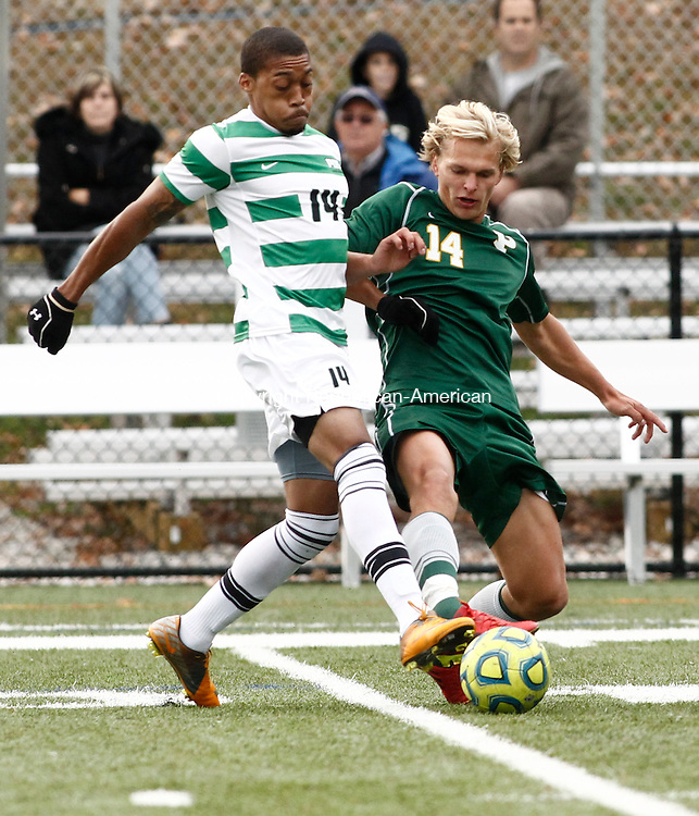 Waterbury, CT- 23 October 2013-102313CM06-    Post University's Terrell Whitting, left, and LIU Post's Carl Lystad battle for the ball during their soccer match in Waterbury Wednesday afternoon. Post won, 1-0, handing LIU their first loss of the season.   Christopher Massa Republican-American