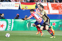 Atletico de Madrid´s Diego Costa (C) and Milan´s Adil Rami during 16th Champions League soccer match at Vicente Calderon stadium in Madrid, Spain. March 11, 2014. (ALTERPHOTOS/Victor Blanco)