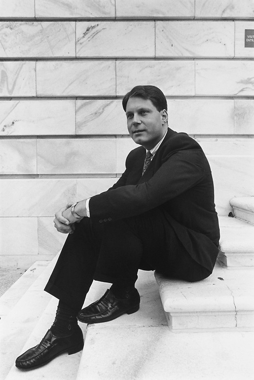 Rep. Peter G. Torkildsen, R-Mass., sitting on steps in October, 1993. (Photo by Maureen Keating/CQ Roll Call)