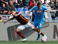 Calcio, Serie A: Roma vs Napoli. Roma, stadio Olimpico, 25 aprile 2016.<br /> Napoli&rsquo;s Allan, right, is challenged by Roma&rsquo;s Diego Perotti during the Italian Serie A football match between Roma and Napoli at Rome's Olympic stadium, 25 April 2016.<br /> UPDATE IMAGES PRESS/Riccardo De Luca