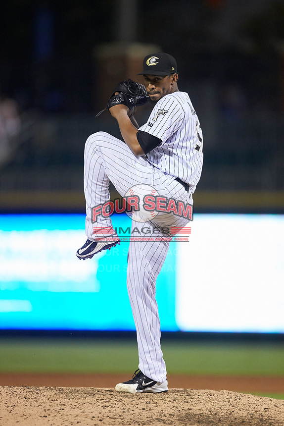 Charlotte Knights relief pitcher Juan Minaya (31) in action against the Scranton/Wilkes-Barre RailRiders at BB&T BallPark on August 14, 2019 in Charlotte, North Carolina. The Knights defeated the RailRiders 13-12 in ten innings. (Brian Westerholt/Four Seam Images)
