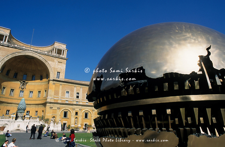 Golden Orb sculpture and fountain in the Court of Pigna in the Vatican Museum, Vatican City, Rome, Italy.