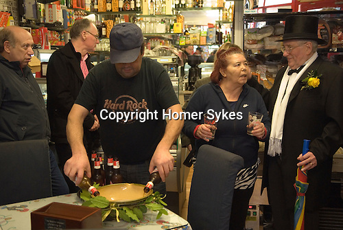 Bodmin Wassailers old New Years Day 6th January 2016 Cornwall. Refreshments,  the Wassaile bowl is being filled with Portugese beer by Rui Santos, and charming assistant at Mirita's Delicatessen.