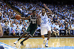 27 December 2014: UAB's William Lee (34) and North Carolina's Brice Johnson (11). The University of North Carolina Tar Heels played the University of Alabama Birmingham Blazers in an NCAA Division I Men's basketball game at the Dean E. Smith Center in Chapel Hill, North Carolina. UNC won the game 89-58.
