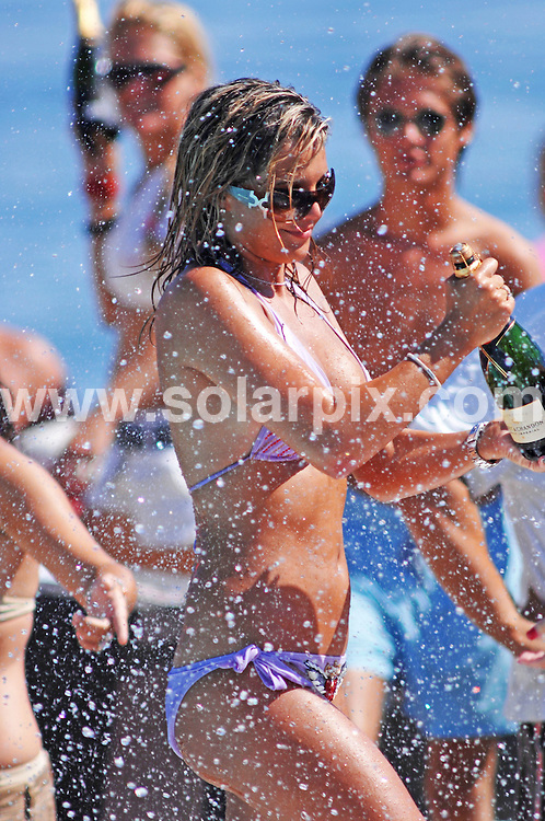 **ALL ROUND EXCLUSIVE PICTURES FROM SOLARPIX.COM**.**WORLDWIDE SYNDICATION RIGHTS**.Former Miss UK and Big Brother housemate, Danielle Lloyd topped up her sun tan on another weekend visit to Marbella, Spain. She attended the Sintilate Champagne Party at a beach club in Puerto Banus, where she partied in and out of the water, with friends and got cosy with two mystery men..JOB REF:  4397    CS1 / JGS       DATE: 29.07.07.**MUST CREDIT SOLARPIX.COM OR DOUBLE FEE WILL BE CHARGED* *UNDER NO CIRCUMSTANCES IS THIS IMAGE TO BE REPRODUCED FOR ANY ONLINE EDITION WITHOUT PRIOR PERMISSION*