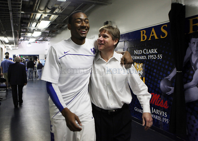 John Wall and assistant coach John Robic walk out to warm up for the SEC Finals on Sunday, March 14, 2010. Photo by Britney McIntosh | Staff