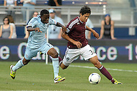 Rapid's forward Tony Cascio (32) pursued by Sporting midfielder Peterson Joseph..Sporting Kansas City defeated Colorado Rapids 2-0 in Open Cup play at LIVESTRONG Sporting Park, Kansas City, Kansas.
