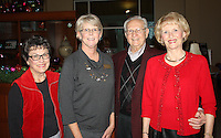 NWA Democrat-Gazette/CARIN SCHOPPMEYER Georgia Thompson (from left), Mary McKinney and Horace and Jeretta Hardwick gather at a reception in honor of McKinney on Dec. 13 at Circle of Life Hospice in Springdale. McKinney is retiring as the nonprofit organization's CEO.