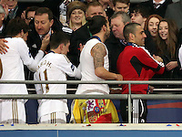 Pictured: Swansea City FC chairman Huw Jenkins (TOP L) embraces Michu (L) as fellow players Pablo Hernandez, Chico Flores and Itay Shechter walk through on the stadium balcony. Sunday 24 February 2013<br /> Re: Capital One Cup football final, Swansea v Bradford at the Wembley Stadium in London.