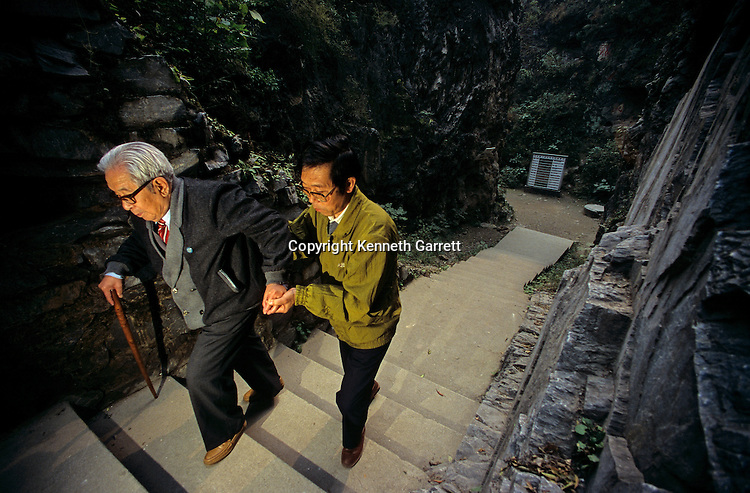 Jia Lanpo with his son, Peking man, Zhoukoudian caves, China.