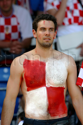 13 June 2004: A Croatian fan with a painted chest at the Euro 2004 Group B game between Switzerland and Croatia at the Estadio Dr. Magalhaes Pessoa, Leiria, Portugal. Photo: Glyn Kirk/actionplus..040613 football soccer crowd fancy dress paint flag body