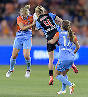 Alyssa Mautz (4) of the Chicago Red Stars and Ellie Brush (8) of the Houston Dash both go up for a header in the first half on Saturday, April 16, 2016 at BBVA Compass Stadium in Houston Texas.
