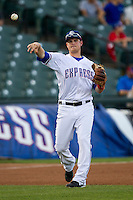 Round Rock Express third baseman Alex Bucholz #5 makes a throw to first base during the Pacific Coast League baseball game against the Memphis Redbirds on April 24, 2014 at the Dell Diamond in Round Rock, Texas. The Express defeated the Redbirds 6-2. (Andrew Woolley/Four Seam Images)