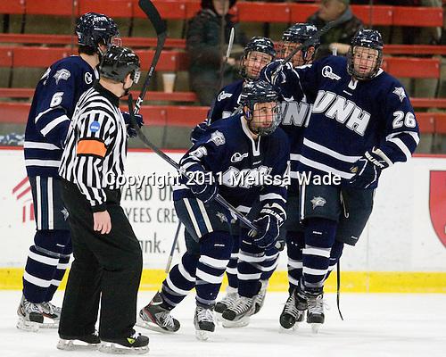 Trevor van Riemsdyk (UNH - 6), John Henrion (UNH - 16) (Downing, Hardowa) Greg Burke (UNH - 26) - The Harvard University Crimson defeated the University of New Hampshire Wildcats 7-6 on Tuesday, November 22, 2011, at Bright Hockey Center in Cambridge, Massachusetts.