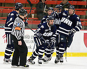 Trevor van Riemsdyk (UNH - 6), John Henrion (UNH - 16) (Downing, Hardowa) Greg Burke (UNH - 26) - The Harvard University Crimson defeated the University of New Hampshire Wildcats 7-6 on Tuesday, November 22, 2011, at Bright Hockey Center in Cambridge, Massachusetts.