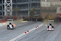 Mar 30, 2014; Las Vegas, NV, USA; NHRA top fuel driver Terry McMillen (left) alongside Steve Torrence during the Summitracing.com Nationals at The Strip at Las Vegas Motor Speedway. Mandatory Credit: Mark J. Rebilas-