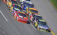Oct 5, 2008; Talladega, AL, USA; NASCAR Sprint Cup Series driver Jimmie Johnson (48) and Elliott Sadler (19) lead a pack of cars during the Amp Energy 500 at the Talladega Superspeedway. Mandatory Credit: Mark J. Rebilas-