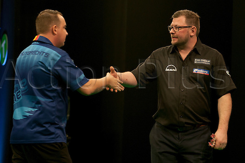 31.01.2016. ArenaMK, Milton Keynes, England. Unibet Masters Darts Championship.  Kim Huybrechts [BEL] congratulates James Wade [ENG] after their match.  James Wade [ENG] won the match 10-5.
