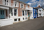Sea front holiday homes on the promenade, Aldeburgh, Suffolk, England. Aldeburgh became a holiday resort in Victorian times and retains an air of quiet gentility. It also retains its popularity especially in mid summer.