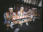 Parade goers take a break while waiting for float in front of them to continue down the main street in Aomori Japan. Huge illuminated paper-mache floats made of lumber, bamboo, wire and paper depicting men, animals and birds are pushed and pulled through the streets by groups of men, women and children during the Nebuta Festival in Aomori, Japan.  The festival dates back to the beginning of the eight century when the Ezo residents in northern Honshu rose in revolt. The Emperor sent General Sakanoue-no-Tamramaro, who, built Nebuta dummies of men and horses which were floated away at night. The Ezo thinking the Imperial troops had withdrawn, came back into the city only to be slaughtered by troops waiting in secret. Themes of the floats are picked from Kabuki stages, historical characters or fairy tales. (Jim Bryant Photo).....
