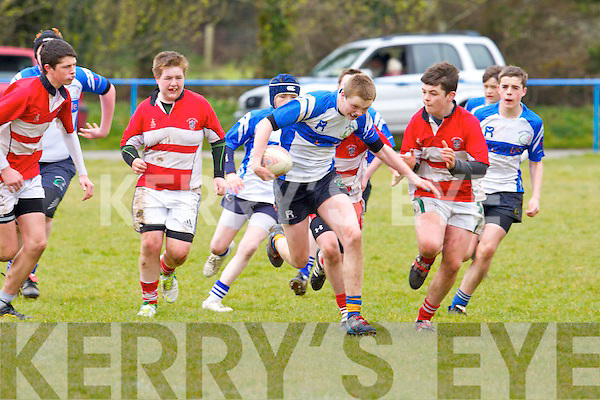 Chorca Dhuibhne's Cian Cuffe chases Tralee's Cillian O'Riordan in the West Munster U15 Cup semi-final at O'Dowd park, Tralee on Saturday.