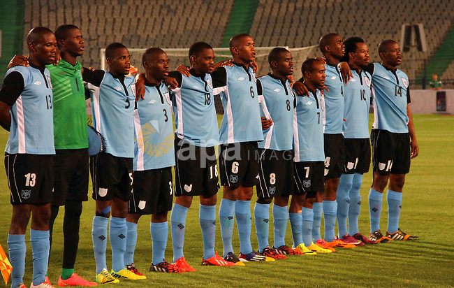 Botswana's players line-up prior to their Africa Cup of Nations 2015 qualifying football match against Egypt at Cairo stadium in the Egyptian capital on October 15, 2014. Egypt won the match with 2-0. Photo by Amr Sayed
