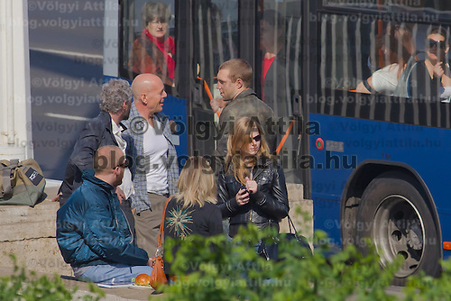 US actor Bruce Willis (C) with costars Jai Courtney (R) of Australia and Sebastian Koch (L) of Germany are seen during a shooting of the fifth piece in the Die Hard series titled Good Day to Die Hard during a shooting day in Budapest, Hungary on May 19, 2012. ATTILA VOLGYI