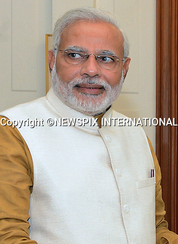 NARENDRA MODI AND PRESIDENT PRANAB MUKHERJEE<br /> The right-wing leader of the Bharatiya Janata Party has been invited to form the next government of India following the party's victory in the recent election_20/05/2014<br /> Narendra Damodardas Modi will be sworn in as the 14th Prime Minister of India on 26th May 2014<br /> Mandatory Credit Photos: NEWSPIX INTERNATIONAL<br /> <br /> **ALL FEES PAYABLE TO: &quot;NEWSPIX INTERNATIONAL&quot;**<br /> <br /> PHOTO CREDIT MANDATORY!!: NEWSPIX INTERNATIONAL(Failure to credit will incur a surcharge of 100% of reproduction fees)<br /> <br /> IMMEDIATE CONFIRMATION OF USAGE REQUIRED:<br /> Newspix International, 31 Chinnery Hill, Bishop's Stortford, ENGLAND CM23 3PS<br /> Tel:+441279 324672  ; Fax: +441279656877<br /> Mobile:  0777568 1153<br /> e-mail: info@newspixinternational.co.uk