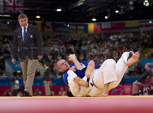 02.08.2012. London, England. Dimitri Peters ger on top in his Fight in the Round of last 32 against Ariel Zeevi ISR Judo men class 100 kg in Excel Center at  Olympic Summer Games