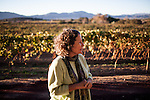 BAJA CALIFORNIA - NOVEMBER 25, 2013:  Natalia Badan, owner of the Mogor Badan winery, in her Valle de Guadalupe vineyard. Badan, a lifelong resident of the valley, and others in Mexico's wine country are protesting the mayor's relaxing of zoning regulations they say will lead to a drastic change in the culture of  the popular tourist destination.  CREDIT: Max Whittaker for The New York Times