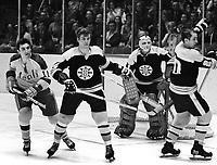 Boston Bruins Bobby Orr, goalie Ed Johnston and #20 Dallas Smith along with Seals #11 Don O'Donoghue. (1971 photo/Ron Riesterer)