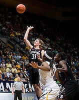 Berkeley, CA - March 4th, 2012: Toni Kokenis of Stanford shoots the ball during a basketball game against California in Berkeley, California.   Stanford won, 86-61.