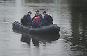 Kailua, HI - December 25, 2009 -- United States Coast Guard personnel in position near a canal near the residence as we drove back from Kaneohe Corps Base Hawaii back to the residence located in Kailua, Oahu, Hawaii, Christmas Day, Friday, December 25, 2009..Credit: Cory Lum / Pool via CNP