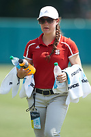 North Carolina State Wolfpack athletic trainer Ashley Doozan helps keep the umpires hydrated during the game against the Northeastern Huskies at Doak Field at Dail Park on June 2, 2018 in Raleigh, North Carolina. The Wolfpack defeated the Huskies 9-2. (Brian Westerholt/Four Seam Images)