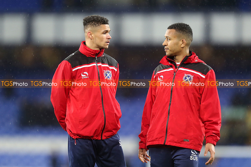 Joe Widdowson and Kane Ferdinand of Dagenham and Redbridge watm down after Everton vs Dagenham and Redbridge at Goodison Park