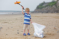 2018 06 09 William Mosley who loves picking up  plastic litter, Tenby, UK