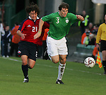 Dublin Ireland. Irelands No 3 Kevin Kilbane holds off Chile no 21 Manuel Iturra Urrutia during the friendly soccer international at Lansdowne road Dublin Ireland 24/5/06.Photo AFP/NEWSFILE/FRAN CAFFREY..(Photo credit should read AFP PHOTO/FRAN CAFFREY/NEWSFILE)...This Picture has been sent you under the condtions enclosed by:.Newsfile Ltd..the Studio,.Millmount Abbey,.Drogheda,.Co Meath..Ireland..Tel: +353(0)41-9871240.Fax: +353(0)41-9871260.GSM: +353(0)86-2500958.email: pictures@newsfile.ie.www.newsfile.ie.FTP: 193.120.102.198..This picture is from Fran Caffrey@newsfile.ie