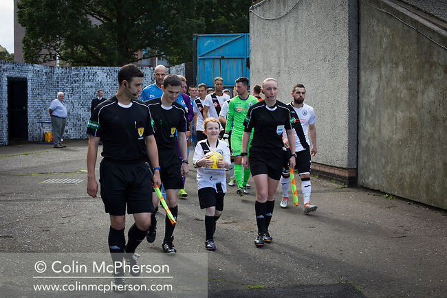 Edinburgh City and Berwick Rangers players walking from the dressing rooms prior to the team's SPFL2 match at Meadowbank. Despite taking the lead in the 66th minute through Ousman See's goal, City lost the game 2-1, watched by a crowd of 410 and remained without a point at the foot of the table after four League games.