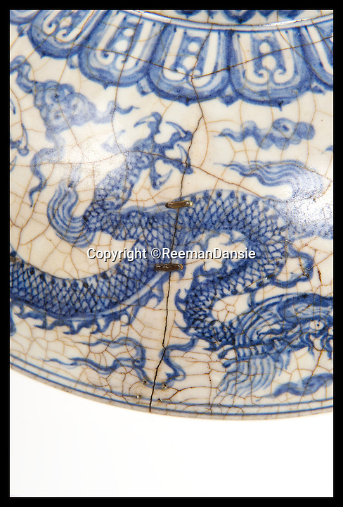 BNPS.co.uk (01202 558833)<br /> Pic: ReemanDansie/BNPS<br /> <br /> ***Please Use Full Byline***<br /> <br /> The Chinese bowl that Major JAck Tullcoh brought back from China. <br /> <br /> A battered bowl that was until recently the favourite sleeping place for a pet cat has sold for 108,000 pounds.<br /> <br /> The 12inch wide bowl has chips, cracks and staples in from where it was once repaired after being broken in two.<br /> <br /> Its owners kept the Chinese piece on a chest of drawers in their hallway and it was used as a bizarre bed for their moggy.<br /> <br /> Auctioneers gave it a 200 pounds estimate but were stunned when it went under the hammer for 90,000 pounds, or 108,000 pounds including fees.