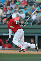 Left fielder Kyri Washington (21) of the Greenville Drive bats in a game against the Columbia Fireflies on Saturday, April 23, 2016, at Fluor Field at the West End in Greenville, South Carolina. (Tom Priddy/Four Seam Images)