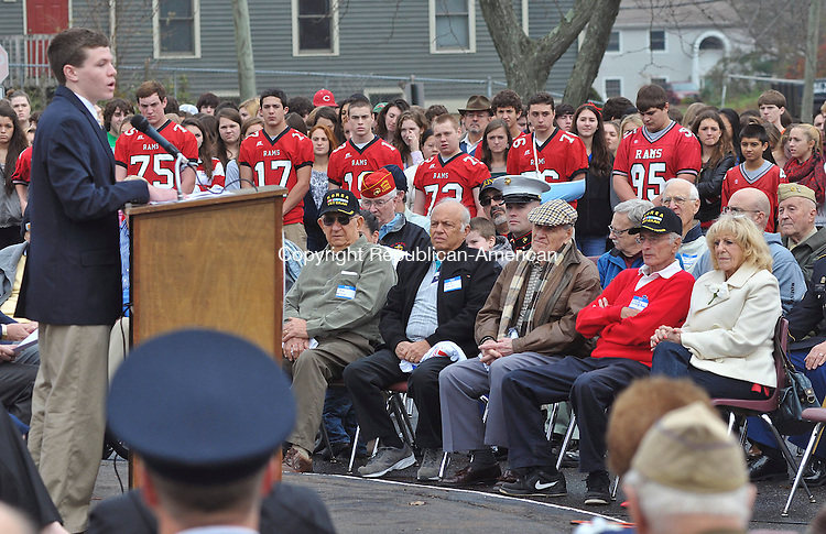 CHESHIRE, CT,  NOVEMBER 12, 2012-  111212JS03- Cheshire High School student Liam Nicholl, a member of the student group B.R.A.V.E. speaks to students and veterans about the meaning of Veterans's Day during a ceremony Monday at Cheshire High School. .Jim Shannon Republican-American