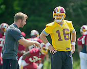 Washington Redskins quarterback Colt McCoy (16) listens to a coach's instructions during an organized team activity (OTA) at Redskins Park in Ashburn, Virginia on Wednesday, May 25, 2015.<br /> Credit: Ron Sachs / CNP
