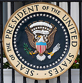 Presidential Seal hanging off the Blue Room Balcony facing the South Lawn of the White House in Washington, DC on April 30, 2019.  <br /> Credit: Ron Sachs / CNP